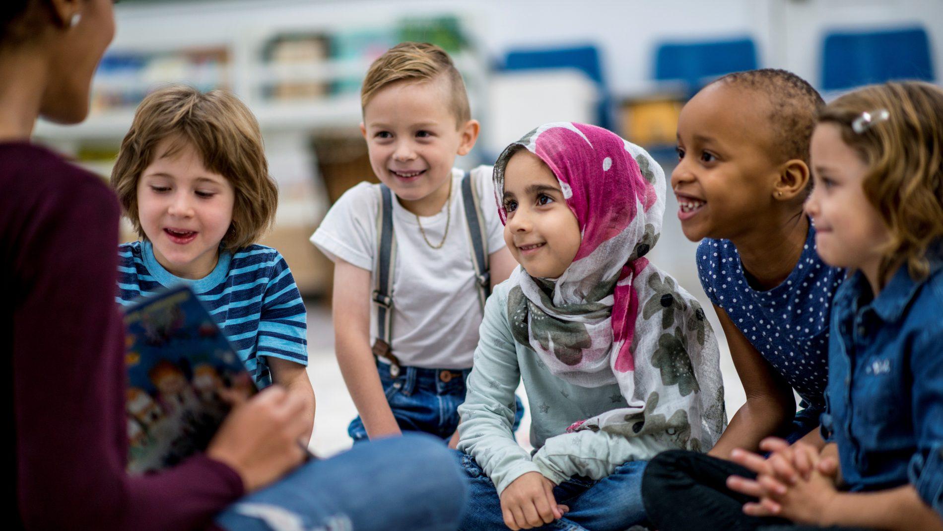 Smiling children listening to story