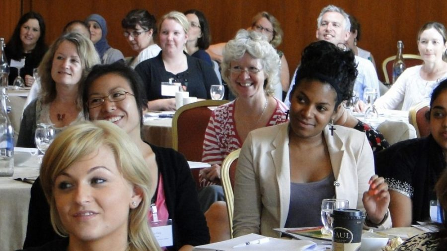Smiling teachers at conference